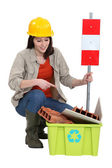 Female builder pointing to recyclable waste — Stock Photo