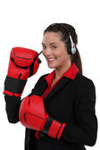 Telephonist wearing boxing gloves — Stock Photo