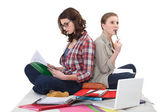 Female students cramming for exam — Stock Photo