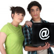 Young couple with a laptop — Stock Photo