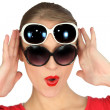 Womwearing two pairs of sunglasses — Stock Photo #14942177