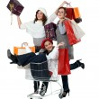 Three girlfriends shopping at the mall — Stock Photo
