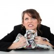 Angry woman clutching papers — Stock Photo