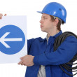 Electrician with a road sign — Stock Photo #14946937