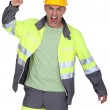 Picture of angry tight-fisted builder — Stock Photo