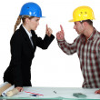Stock Photo: Engineer having argument with tradesman