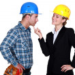 Foto Stock: Architect flirting with builder