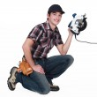 Craftsman holding an electric cutter — Stock Photo #14948501