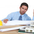 Architect in his office looking angry — Stock Photo #14948873