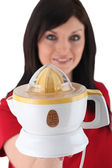 Woman holding electric juicer — Stock Photo