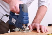 Craftsman working with a drill — Stock Photo
