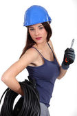 Seductive brunette electrician — Stock Photo