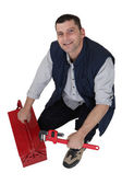 Plumber kneeling next to tool kit — Stock Photo