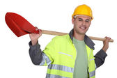 Tradesman carrying a spade on his shoulders — Stock Photo