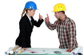 Engineer having an argument with a tradesman — Stock Photo