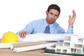 Architect in his office looking angry — Stock Photo