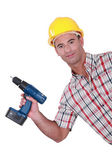 Handyman showing-off his new cordless drill — Stock Photo