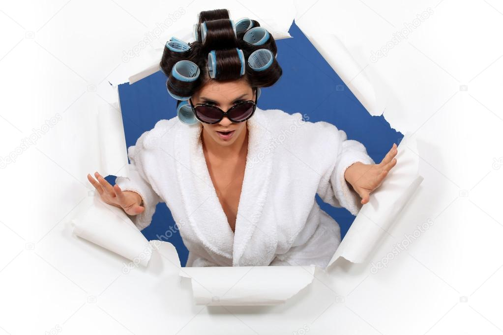 Woman in a bathrobe with her hair in rollers — Stock Photo #14944387