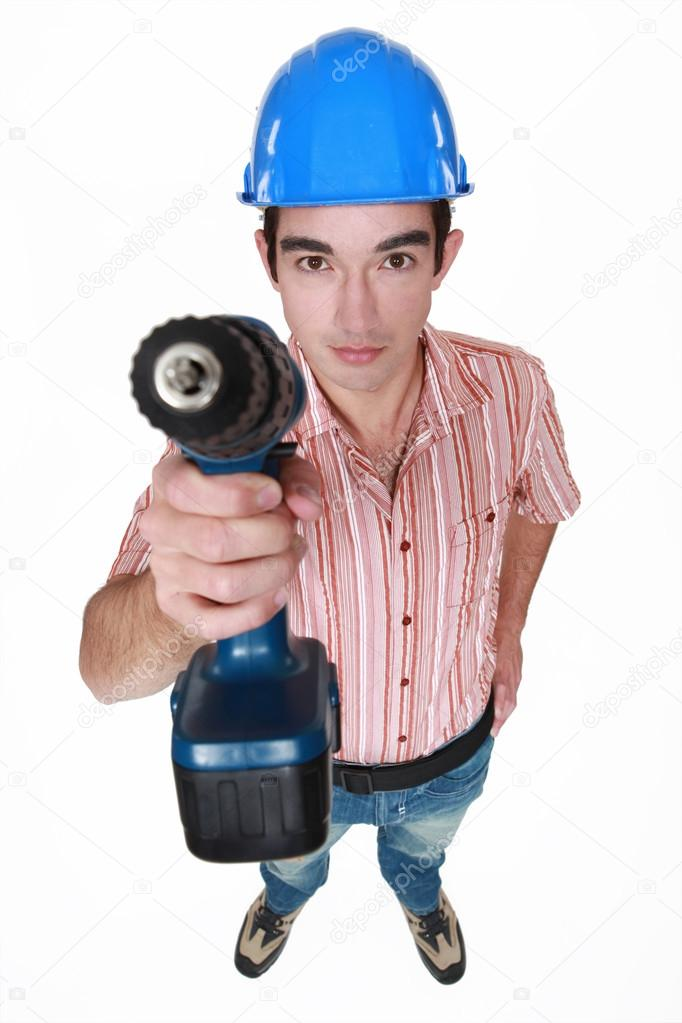 Tradesman holding a power tool — Stock Photo #14948577