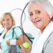 Stock Photo: Women going to play tennis
