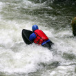 Man navigating water rapids - Stock Photo
