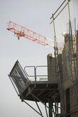 Scaffolding and crane — Stock Photo