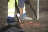 Building spray painting the floor — Stock Photo