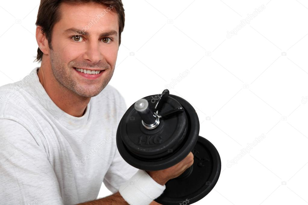 Man lifting a dumbbell — Stock Photo #14951333