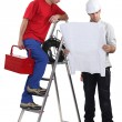 Two handymen working together — Stock Photo