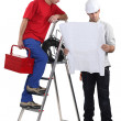 Stock Photo: Two handymen working together