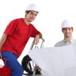 Young electrician and foreman working hand in hand — Stock Photo #15440635