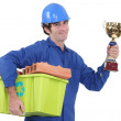 Stock Photo: Bricklayer with award for recycling