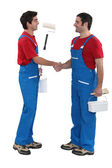 Housepainters handshaking — Stock Photo