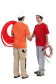 Duo of plumbers shaking hands — Stock Photo