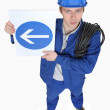 Worker with a one way sign — Stock Photo
