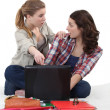 Stock Photo: Students with a laptop