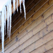 Stalactite on wooden house — Stock Photo #15606221