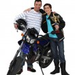 Father and son with motorcycle and trophy — Stock Photo
