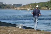 Man fishing by the river — Stock Photo