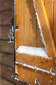 Snow covered shutters — Stock Photo