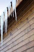 Stalactite on wooden house — Stock Photo