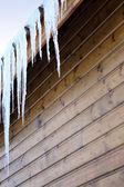 Stalactite on wooden house — Stock Photo