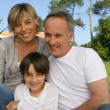 Parents and son in the garden — Stock Photo