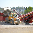 Stock Photo: Digger transferring quarried materials