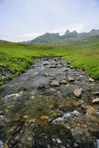 Stream running along mountain top — Stock Photo