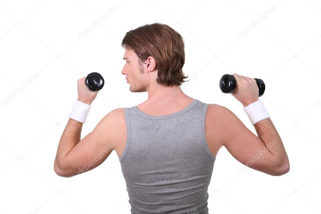 Man working out with dumbbells — Stock Photo #15617705