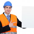 Engineer with a board left blank for your message — Stock Photo #15624555