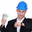 Stock Photo: Wealthy architect checking watch