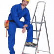 Handymstood casually with ladder — Stock Photo #15629769