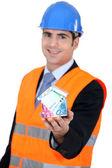 Handsome young architect wearing orange safety jacket and hard hat — Stock Photo